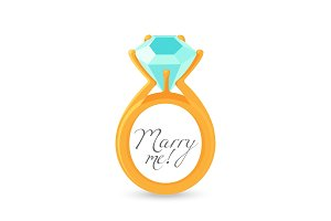Marry me sign and gold engagement ring with diamond