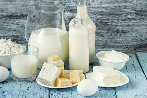 Set of different milk products on the wooden background