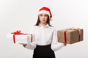 Christmas Concept - young happy caucasian business woman with santa hat choosing gift boxs with copy space on side.