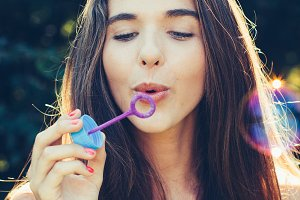 Girl blowing bubbles.jpg