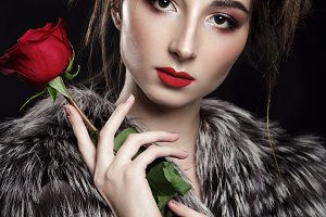 Beautiful model holding a red rose