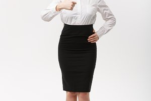 Business Concept - Modern caucasian business woman in the white studio background giving thumb up.