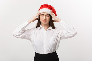 Business Concept - Modern caucasian business woman in christmas theme with serious thoughtful pose.