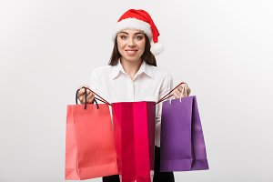 Christmas Concept - beautiful caucasian business woman shocking with gift inside shopping bag.