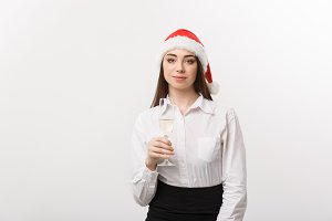 Christmas Celebration - Young beautiful business woman celebrating christmas with glass of champagne.