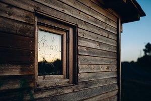 Window detail in a wooden cabin