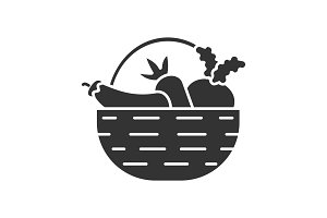 Basket with vegetables glyph icon