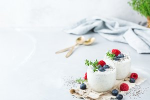 Healthy vegan white chia pudding with berries and green thyme