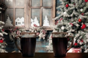 Two mugs with hot coffee or tea