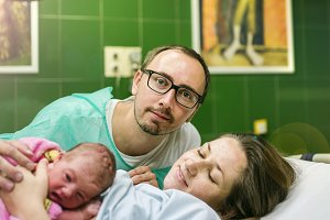 Happy parents and new born baby.