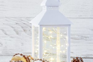 Christmas Lantern on  snow wooden