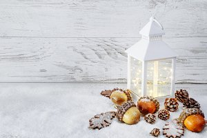 Lantern On Snow with acorns