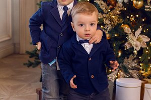 two young brothers in suits standing