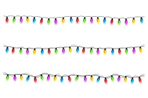 Christmas glowing lights on white background. Garlands with colored bulbs. Xmas holidays. Christmas greeting card design element. New year,winter.