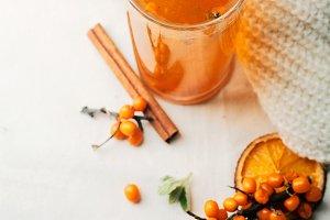 Warm sweet organic tea with sea buckthorn berries