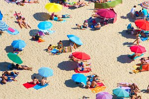 crowded beach in a hot sunny summer