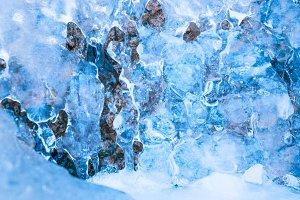 Frozen waterfall in blue ice