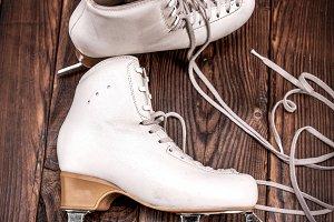 pair of white leather female skates