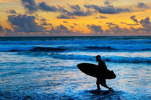 Silhouette of surfer on the beach