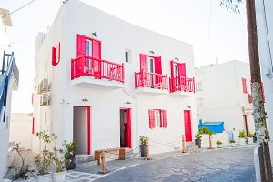 Typical house withe colorful windows and doors in the narrow streets of Mykonos, Greece.