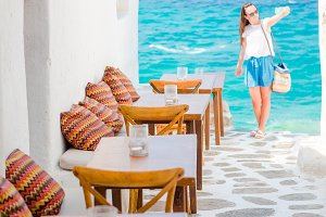 Outdoor cafe in a typical greek outdoor cafe in Mykonos with amazing sea view on Cyclades islands