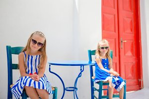 Two girls on vacation in greek village