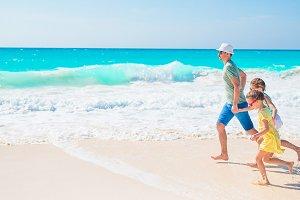 Family on white tropical beach on caribbean island