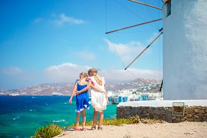 Kids with amazing view on Little Venice the most popular tourist area on Mykonos island