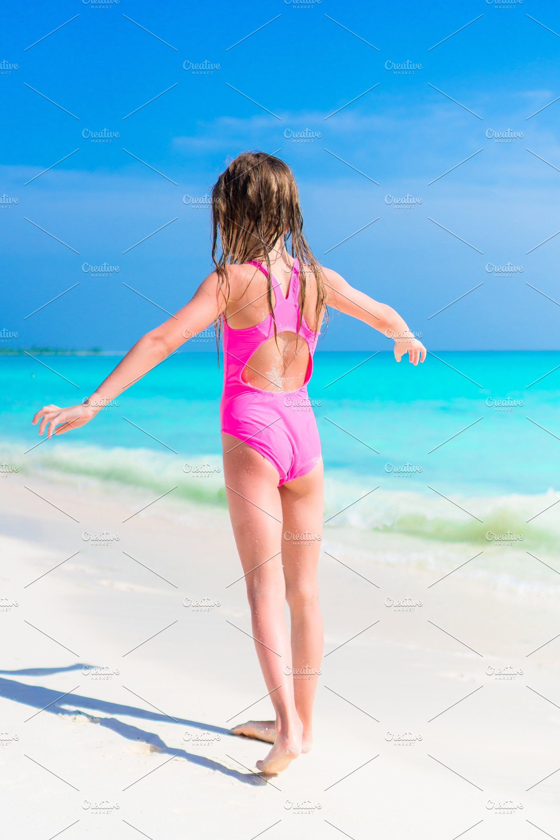 f5da995c03 Adorable little girl in swimsuit on beach vacation ~ People Photos ...