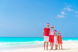 Happy family on beach Christmas vacation