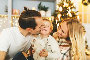 Beautiful family in Christmas interior