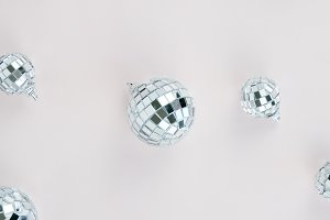 Small disco balls on pink background