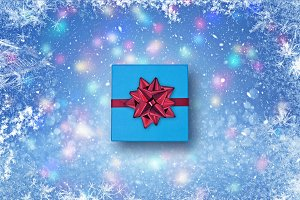 Gift on a blue Christmas background