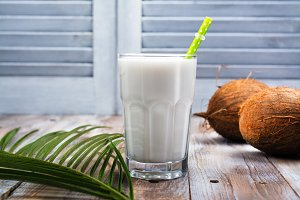 Non dairy vegan coconut milk in a tall glass