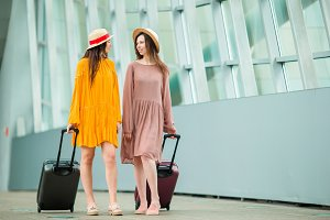 Young tourist women with baggage in international airport&#x2