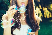 Blowing bubbles girl