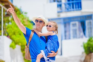 Family in Europe. Happy father and little adorable girl in Mykonos on summer greek vacation