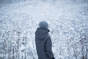 Girl in the winter forest field