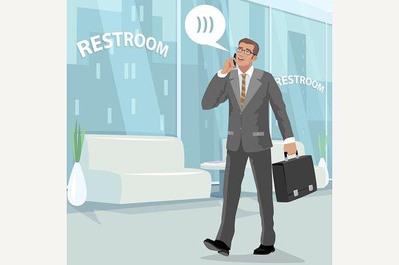 Businessman In Restroom At Work