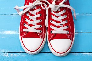 pair of red textile sneakers