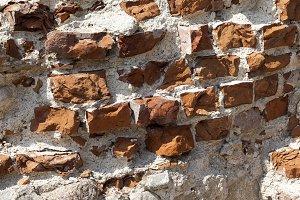 A ruined brick wall close-up