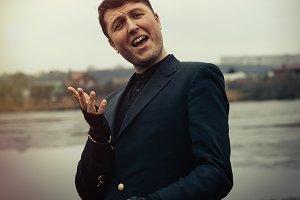 Elegant man in black coat