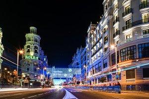 Gran Via Street in Madrid at night on Christmas time with lighti