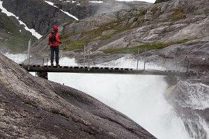 Tourist standing on a  bridge
