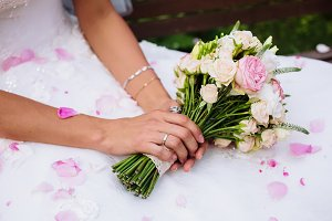 boquet of rose flowers in bride hands