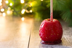 Candy apple and red ribbons