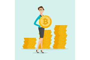 Young successful business woman with bitcoin coin.