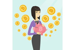 Woman holding a piggy bank with a bitcoin sign.