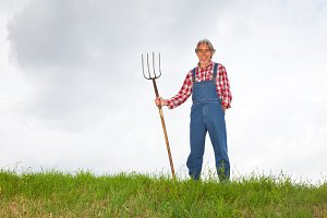 Farmer Standing At The Top Of A Hill