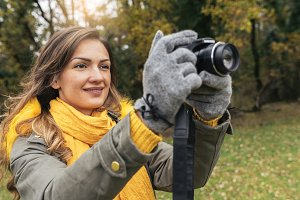 Young woman using a camera.